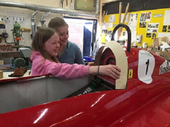 Phoebe and Cerys fix Dylans seat 350 pixels